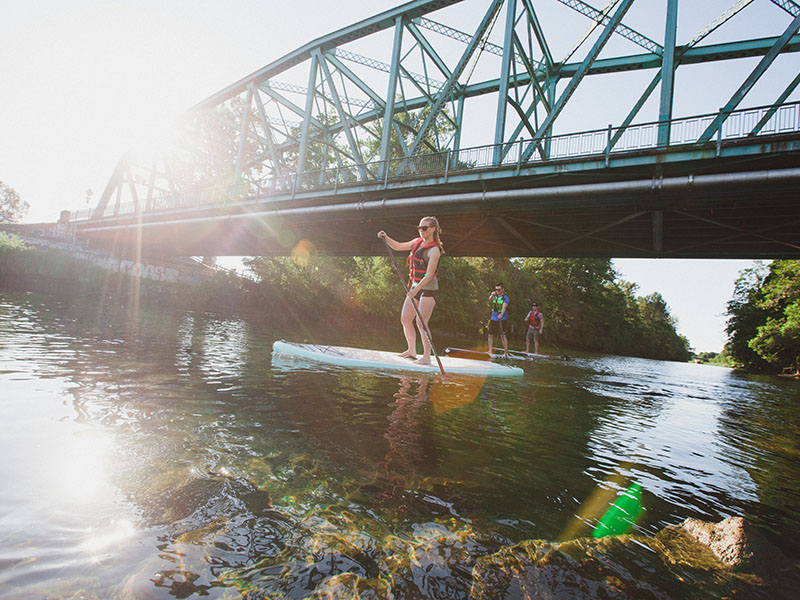 Paddle-boarding in Courtenay, one of the new neighbourhoods